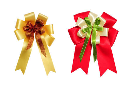 red and yellow satin bow on white background photo
