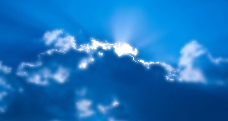 abstract sun rays through the clouds on the sky