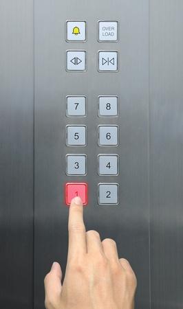 businessman hand press 1 floor in elevator Stock Photo - 9080068