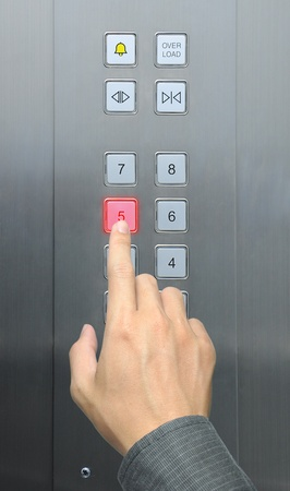 businessman hand press 5 floor in elevator Stock Photo - 9080072
