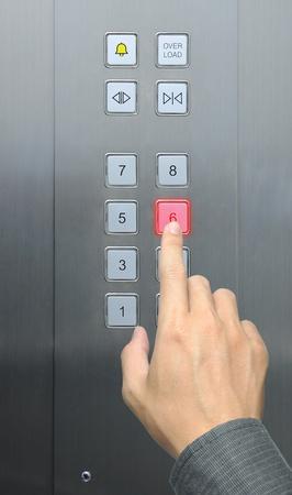 businessman hand press 6 floor in elevator Stock Photo - 9080073