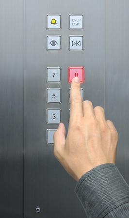 businessman hand press 8 floor in elevator Stock Photo - 9080074