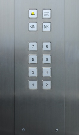 people in elevator: Elevator buttons