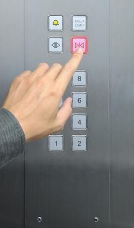 businessman hand press close door button in elevator Stock Photo - 9132182