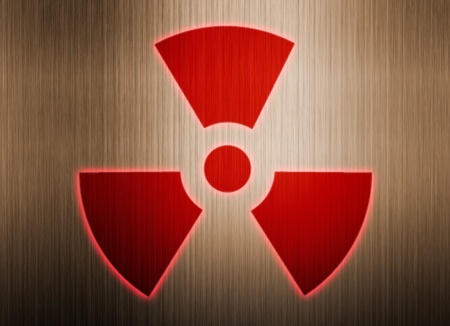 radioactive symbol on metal background Stock Photo - 9132200