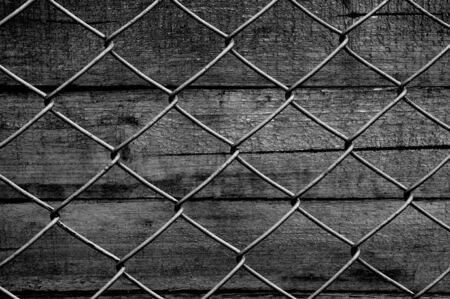 chain fence: chain link fence see old wooden background