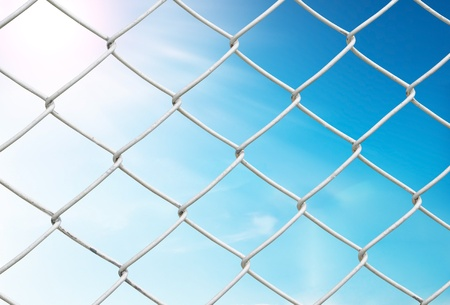 light chains: chain link fence see blue sky