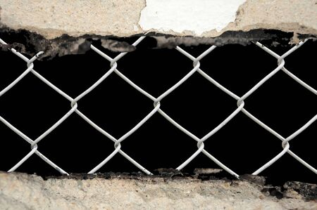 abstract porous wall see the chain link fence Stock Photo - 9358992