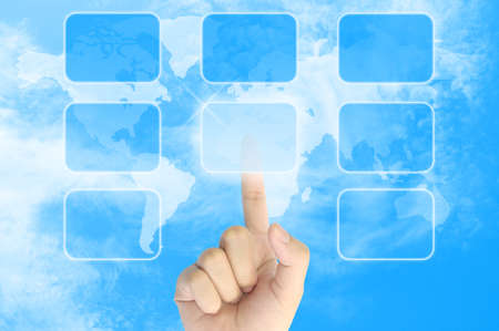 woman hand pushing a button on a touch screen interface in the blue sky Stock Photo - 9456229