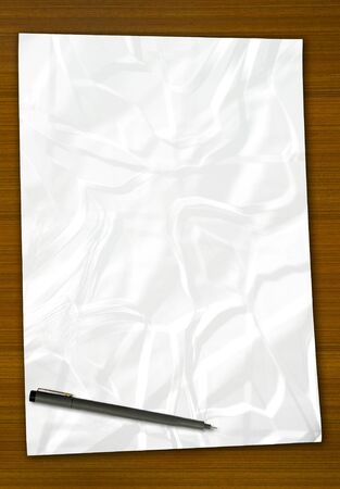 white blank note paper and pen on wood background Stock Photo - 9592871
