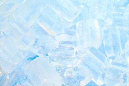 fresh cool ice cube background in blue light photo