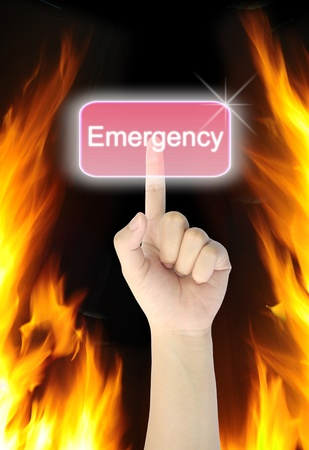 hand pressing emergency button on fire background  photo