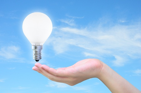 light bulb in women hand on sky Stock Photo - 9881166