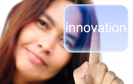 system development: women hand pushing innovation button on a touch screen interface