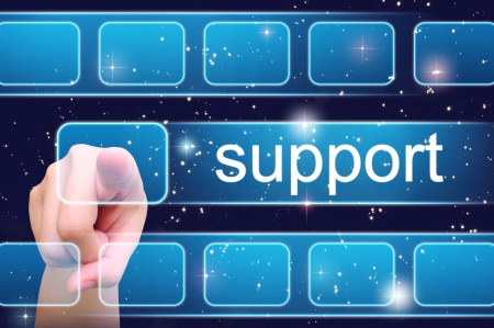 support services: hand pushing support button on a touch screen interface  Stock Photo