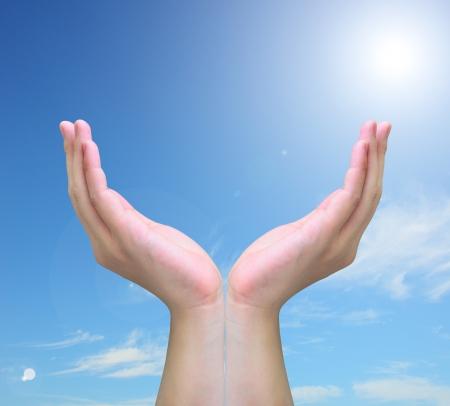 blessing: hand holding on blue sky
