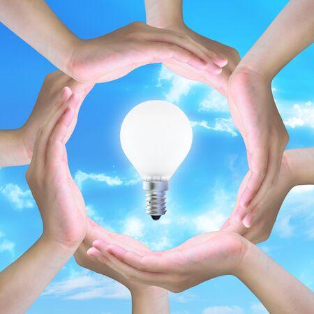 light bulb in women hand making a circle photo