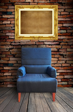 old single sofa seat and frame in front of the wall photo