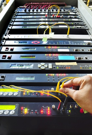 control center: hand working on the communication and internet network server