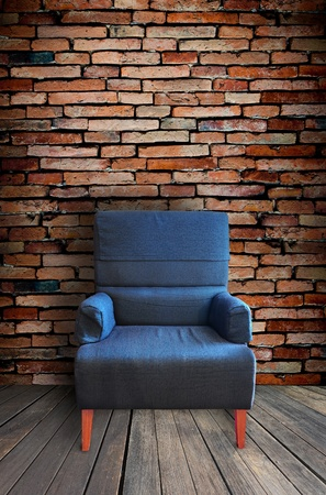 timber bench seat: old single sofa seat in front of the wall Stock Photo
