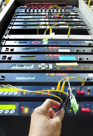 telecommunication equipment: hand working on the communication and internet network server