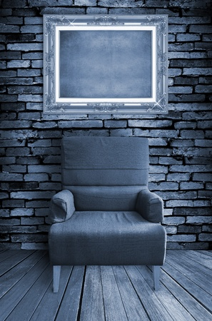 old single sofa seat and frame in front of the wall Stock Photo - 10263960
