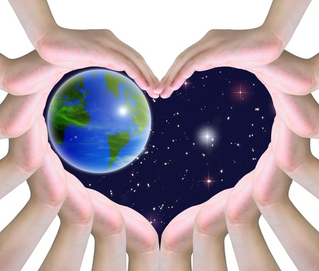 life support: the world in humen hands making a symbol of love Stock Photo
