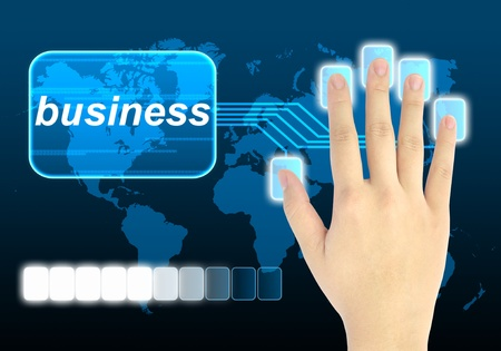 businessman hand pushing business button on a touch screen interface  photo