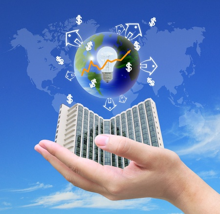 intelligent solutions: businessman hand holding a building Stock Photo