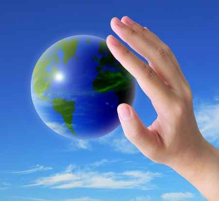 blessing: world and women hand holding on blue sky Stock Photo