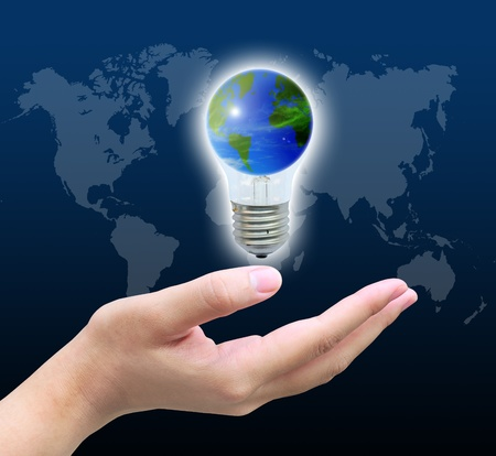 light bulb icon: the world in light bulb on women hand