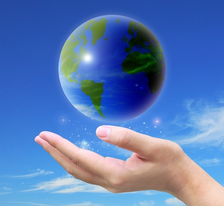world and women hand holding on blue sky photo