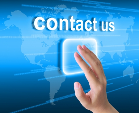 contact info: hand pushing contact us button on a touch screen interface