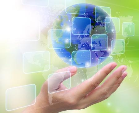 digital globe: world and women hand holding on nature