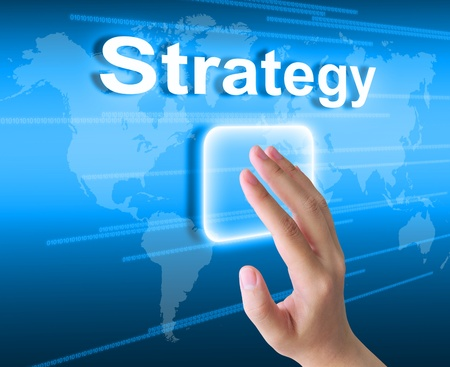 team strategy: hand pushing strategy button on a touch screen interface Stock Photo