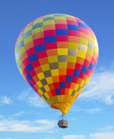 colorful hot air balloon with beautiful blue sky and cloud photo
