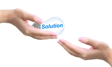 sending solution light bulb on women hand photo