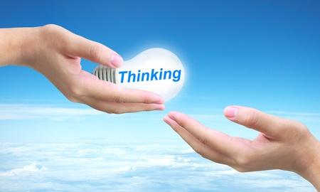 sending thinking light bulb on women hand photo