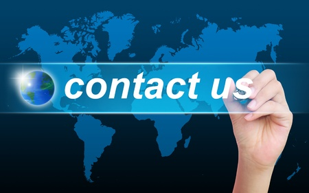 contact information: women hand writing contact us Stock Photo