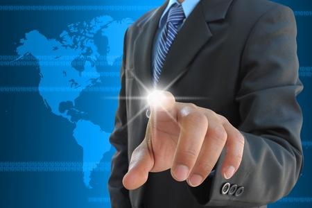 at tech: businessman hand pushing a touch screen interface