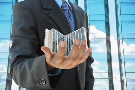 businessman hand holding a building Stock Photo