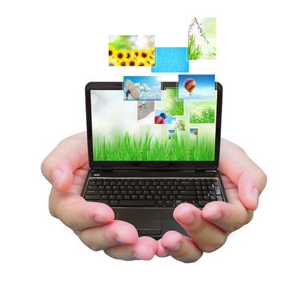paper screens: laptop PC and streaming images virtual buttons on women hand Stock Photo