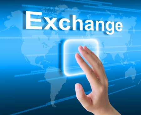 global currencies: hand pushing exchange button on a touch screen interface  Stock Photo