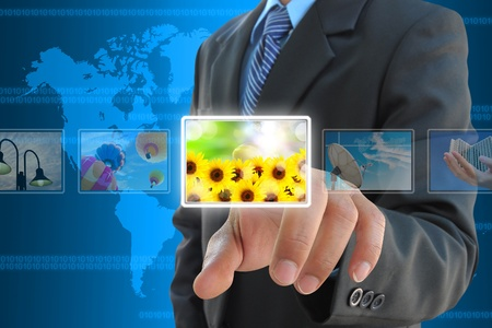 businessman hand pressing a button streaming images on a touch screen interface Stock Photo - 11968862