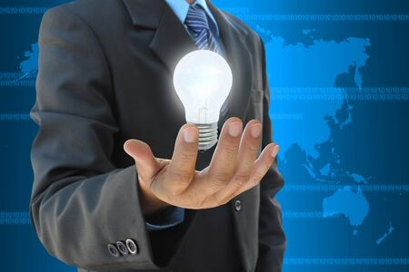 businessman hand holding light bulb photo