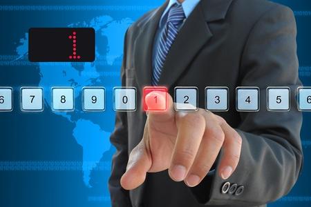 touch down: businessman hand pressing 1 floor in elevator