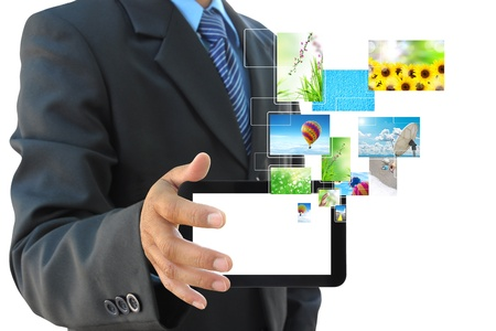 broadband: businessman hand holding touch pad PC on white background