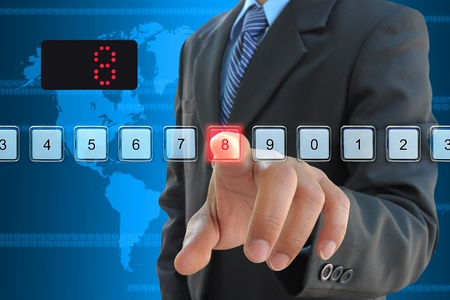 touch down: businessman hand pressing 8 floor in elevator Stock Photo