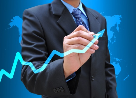 businessman hand drawing business graph Stock Photo - 12164353