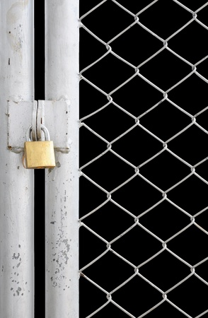 chain link fence: chain link fence and metal door with lock isolated on black